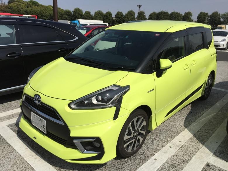 fluorescent yellow toyota minivan